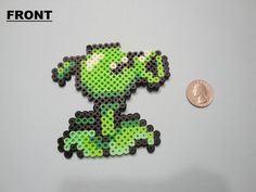 PLANTS VS. ZOMBIES GREEN PEA SHOOTER PERLER BEAD SPRITE **NOTE** This sprite comes as is. (See photos above; front & back.) HANDLE WITH CARE.