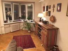 Serbian family home in Moscow. wooden table,  icons, living room, wood, furniture