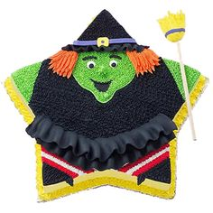 Witch Way to Go Cake - This witch is just tu-tu cute! Wilton petal tips are used to make  the ruffles that give this cake extra dimension.