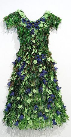 In this lovely frock I shall blend with my neighbor's foundation plantings. ~~~~~ Liza and the Code of Art - sculpture by Karen Norgard Design Textile, Floral Design, Botanical Fashion, Floral Fashion, Fairy Dress, Karen, Unique Outfits, Flower Dresses, Beaded Flowers