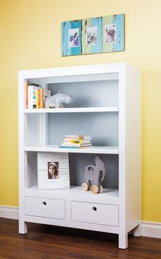 Cody Bookcase - modified to be shorter and wider to go under window.  Blue drawers like the Devon with Campaign hardware