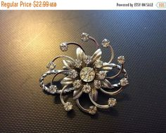 Summer Sale Large rhinestone and silver toned brooch by EMTWTT