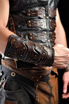 Post apocalyptic men's leather bracer 'Apocalypse by Atomfashion Leather Bracers, Leather Vest, Leather Pouch, Black Leather, Leather Jackets, Thigh Bag, Apocalypse Fashion, Viking Armor, Leather Stamps