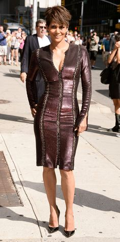 Halle Berry wowed at her appearance on the Late Show with David Letterman in a metallic plum Atelier Versace dress with vertical openwork detailing, accessorizing with jewelry by Jack Vartanian, Sutra, Antonini, and Borgioni, and black Ruthie Davis pumps.