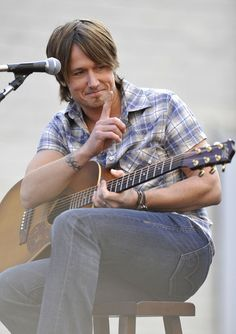 Popular Australian country musician Keith Urban.  Keith is based in Nashville USA and has become an international star.  He is married to Australian Actress Nicole Kidman, and they have 2 daughters together.  Appearing in TV Programmes as a judge on The Voice in Australia and American Idol.
