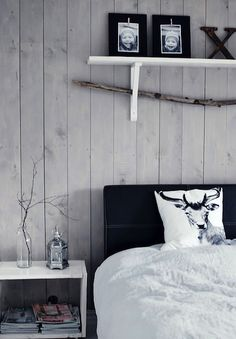 Using reclaimed wood along the wall the head of your bed lies up against to pull focus.