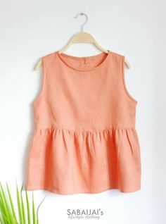 Check out this item in my Etsy shop https://www.etsy.com/uk/listing/510337975/orange-linen-top
