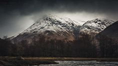 Looming Peaks - A landscape image of the munros surrounding Glen Etive, in the Highlands of Scotland, on a dark and stormy day.