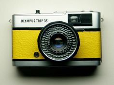 Olympus Trip 35 - refurbished 1970s film camera, yellow. $85.00, via Etsy.