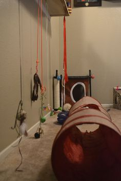 Used the empty space below the bar to hang cat toys! We will never get stools to go there so might as well!