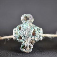 Amlash bronze bead 1, 1st millenium B.C. Private collection