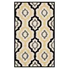 Wool rug with a quatrefoil ogee motif. Hand-tufted in India.   Product: RugConstruction Material: WoolCo...