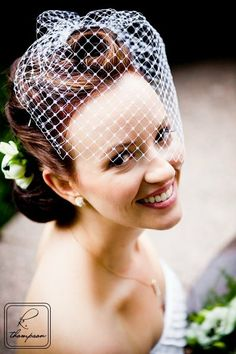 close-to-perfect hair and veil (rhinestone pin instead of flower, and decoration on the veil)