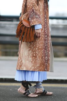 London Street Style That Just Oozes Cool #refinery29 http://www.refinery29.com/2016/02/103453/london-fashion-week-fall-winter-2016-street-style-pictures#slide-38 Statement bag, statement coat, statement shoes. Check, check, check....