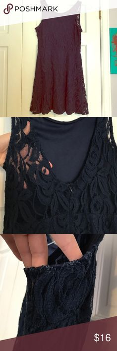 Navy blue lace boutique dress Super cute and flowy lace navy blue dress with scoop back. Minor wear, some fading on the material at the armpits as pictured. Bundle to save more money. Not free people just for exposure Free People Dresses