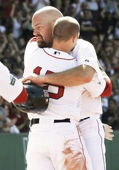This sums it up! We are gonna miss you Youk! Kevin Youkilis #20 of the Boston Red Sox is hugged by teammate Dustin Pedroia #15 after being taken out of the game during the seventh inning of the interleague game against the Atlanta Braves at Fenway Park on June 24, 2012 in Boston, Massachusetts. (Photo by Winslow Townson/Getty Images)