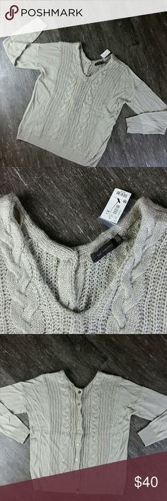 The Limited NWT The Limited NWT XL  Beige Cable Knit  V-Neck Sweater  Button Down Back This sweater is very Lightweight and SO Soft!  Absolutely Adorable!  Original $59.90  26 inch sleeves 50 inch bust 27 inch total length measured from top center shoulder to bottom of shirt The Limited Tops