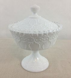 Items similar to Vintage Milk Glass Lidded Pedestal Bowl, Fenton Art Glass, Spanish Lace Sliver Crest Pattern, Circa 1965 on Etsy Fenton Milk Glass, Fenton Glassware, Vintage Glassware, Cobalt Glass, Vintage Pottery, Carnival Glass, Glass Collection, Antique Glass, Colored Glass