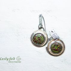 Silver author earrings with hot enamel.  Decorated with brass. Hundertwasser style.