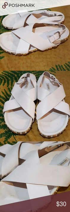 Marc Jacobs Birkenstock Like Stud Shoes Sandals 39 Amazing white leather Marc Jacobs sandals. (Foot bed molded like Birkenstocks). Studded all around on sole exterior. Made in Italy. Size 39. Overall good condition.  Tiny crease mark on one strap from storage and some minor scuffing and footbed dirt.  Still look great and fab deal!! Marc Jacobs Shoes Sandals
