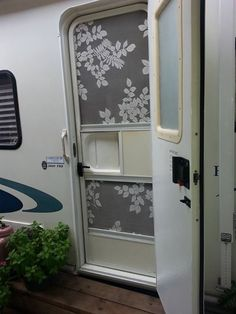 Lacy screen door on travel trailer