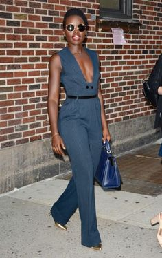 Who: Lupita Nyong'o When: September 18, 2015 Why: Lupita Nyong'o's pinstripe jumpsuit with a plunging neckline will take you from the office (with a camisole underneath) to cocktail hour in one fell swoop. She adds some cool to her look with funky glasses and matching metallic pumps.