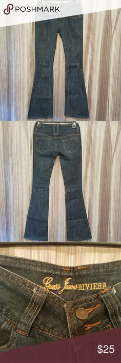??GUESS JEANS RIVIERA BOOTCUT Medium/ dark wash GUESS jeans. Riviera Bootcut fit. Double button closure in front, pockets in back. Low rise. Size 25 = 2/3 Guess Jeans Boot Cut