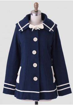 This vintage-inspired coat adorned with bows and nautical details is making us smile!