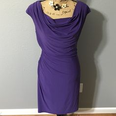 Purple dress Beautiful purple dress from dress barn. Small snag to the back of dress near the left armpit which is pictured and barely noticeable! Gathers to the right side for a flattering fit! Dress Barn Dresses Midi