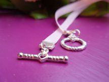 When making ribbon jewelry, it's important to know how to finish it off so as to avoid frayed ends. This tutorial on How to Attach Ribbon Crimps will show you how to give your ribbon necklace a clean, polished look.