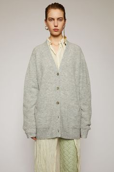 Acne Studios grey melange cardigan is crafted in a full cardigan stitch from an alpaca and wool blend and shaped to a relaxed fit with exposed seams running along the shoulders. V Neck Cardigan, Oversized Cardigan, Direct Marketing, Fashion Studio, Acne Studios, Wool Blend, Knitwear, Sweaters For Women, Grey