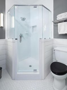 Lovely gray and white bathroom boasts a corner shower fitted with a shiplap and glass enclosure and a polished nickel shower kit fixed to large white hex surround tiles positioned framing a niche. Bathroom Renos, Bathroom Layout, Bathroom Interior Design, Small Bathroom, Master Bathroom, Bathroom Fixtures, Bathroom Canvas, Downstairs Bathroom, Shower Remodel