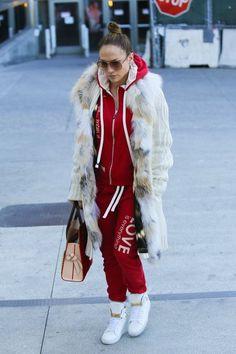 Jennifer Lopez wearing Louis Vuitton Christian Louboutin Shopping Tote, Peace Love World Love Is Everything Tango Kanga Pant and Peace Love World Love Is Everything Tango Love Life Zip-Up Hoodie