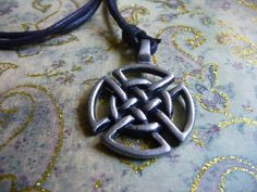Celtic Knot  This Celtic Knot pendant is crafted from pewter. The necklace is set upon black cotton cord that has a slip knot design allowing you to adjust its length. The treasured design of Celtic knot work is the most notorious and recognizable artwork in Celtic history. This symbol is also referred to as the mystic knot, or the endless knot. This beautiful necklace would be perfect for a male or female to wear.  www.etsy.com/shop/natureslace Boho Designs, Celtic Designs, Celtic Knot, Beautiful Necklaces, Black Cotton, Pewter, Mystic, Washer Necklace, Macrame