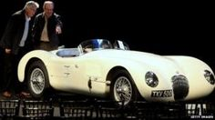 Two men admire a 1952 C-type Jaguar