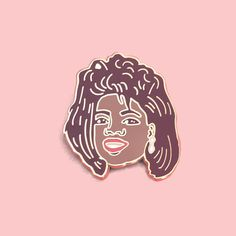 You get a pin and you get a pin!! This enamel pin features the amazing O>P>R>A>H (insert classic Oprah announcement voice here) sporting a rather 80s hairdo.  This will make a great gift for any Oprah fan, as well as makers, designers and pop culture fiends.  Each enamel pin is Maroon, Red, White and Brown with a faux gold plated back and is packaged on card. It has a clutch backing and measures 1 height.  + Why not upgrade to the Oprah Winfrey Enamel Pin: Gold Class Edition. The ...