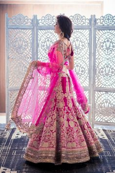 In a magenta raw silk lehenga by Manish Malhotra and jewellery by Amrapali.