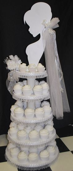 CUPCAKES~Wedding Cupcake Tower -love the silouette . cute idea for a shower. Cupcake Tower Wedding, Wedding Cupcakes, Wedding Cake, Cupcake Towers, Cupcake Stands, Dessert Stand, Birthday Cupcakes, Dessert Table, Bridal Shower Cupcakes