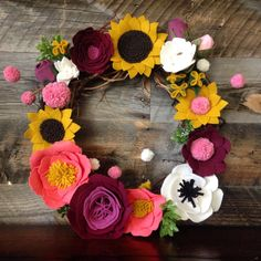 Welcome to my new Collection of felt art! S O C U T I E S H O M E  This colorful felt floral wreath is such a great addition to any decoration and front