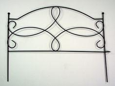 Buy a single piece of garden border to make a headboard.