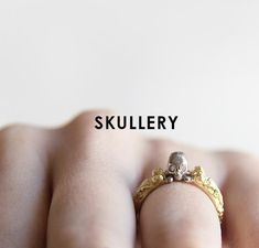 He Holds Us All Ring. Diamond eyed skull and cross bone ring with detailed skeletons designed up the sides in Yellow and White Gold with White Diamond eyes. Diamond Eyes, Skeletons, Raven, Bones, White Gold, Skull, Yellow, Collection, Design