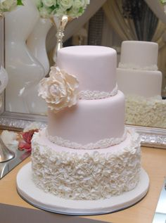 Beautiful peony adorns this classically modern wedding cake.