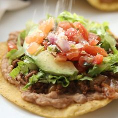 One of my go-to dinners when I need something QUICK and easy is homemade Tostadas made with ground beef (or shredded chicken or pork) refried beans and cheese. Theyre so fresh and tasty and a meal that everyone gets excited for. Mexican Dishes, Mexican Food Recipes, Beef Recipes, Dinner Recipes, Cooking Recipes, Healthy Recipes, Tasty Videos, Food Videos, Croque Mr