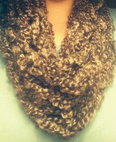 This fuzzy infinity scarf is sure to help keep you warm this winter! It is made from Lion Brand homespun thick and quick yarn. It has a beautiful dark