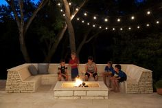 Built-In Stone Seating and Square Fire Pit in Contemporary Patio Design Ideas