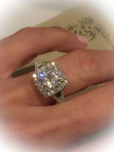 A personal favorite from my Etsy shop https://www.etsy.com/listing/260614118/moissanite-diamond-halo-engagement-ring