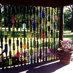 Upcycled bottle wall: 22 Fascinating and Low Budget Ideas for Your Yard and Patio Privacy