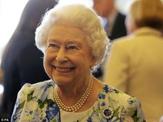 The Queen's mood appeared to improve as she met senior parliamentarians at Buckingham Pala...