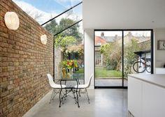 extension de maison en brique et verre