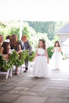 The most adorable flower girls in satin A-line dresses paired with mauve sashes and leafy crowns! {@erikabrownphoto}